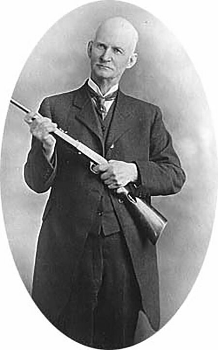 John Browning holding a Browning semi-auto .22 rimfire rifle