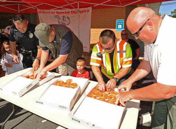 Members of Georgia's Mariettta Police Department give out donuts at an annual fundraiser.