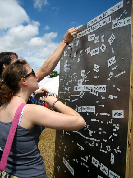 Happy customers at a communal magnetic poetry wall in Suffolk, England.