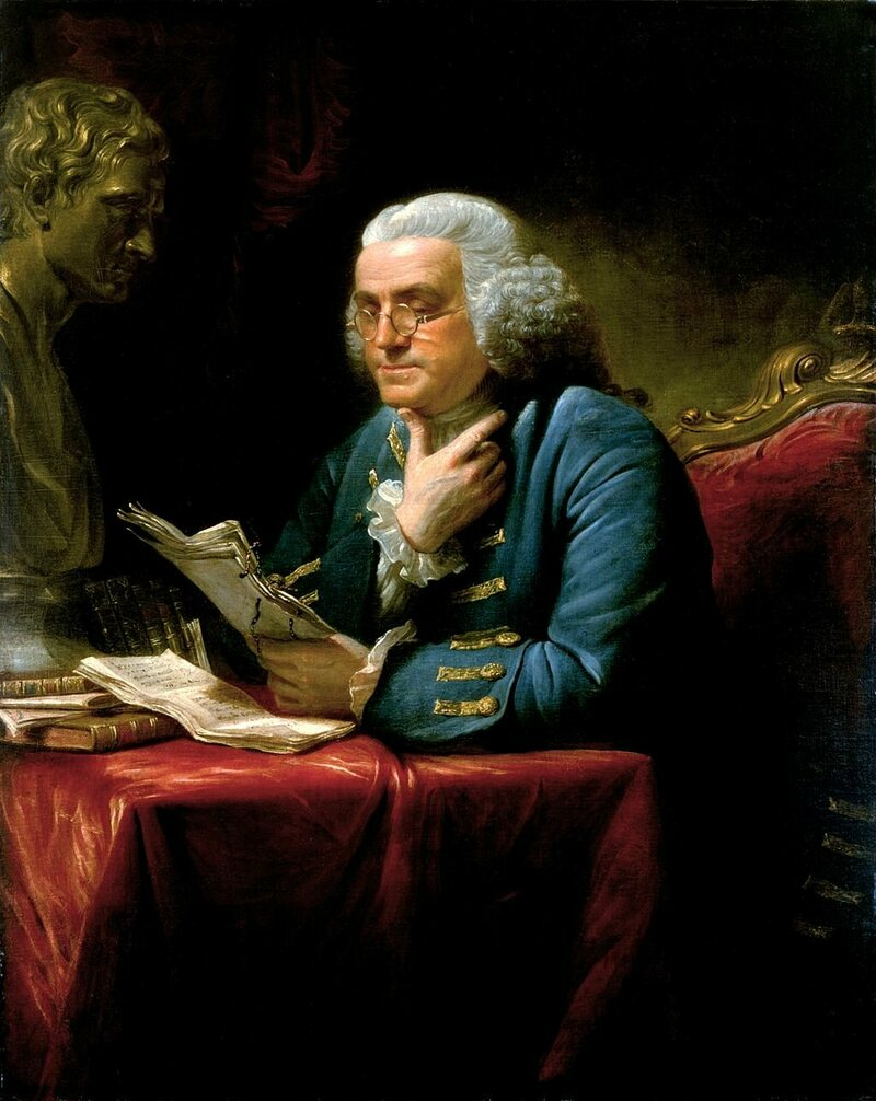 Franklin puzzling over a letter. He had to rely on written correspondence because no one had yet figured out how to harness electricity to invent email.
