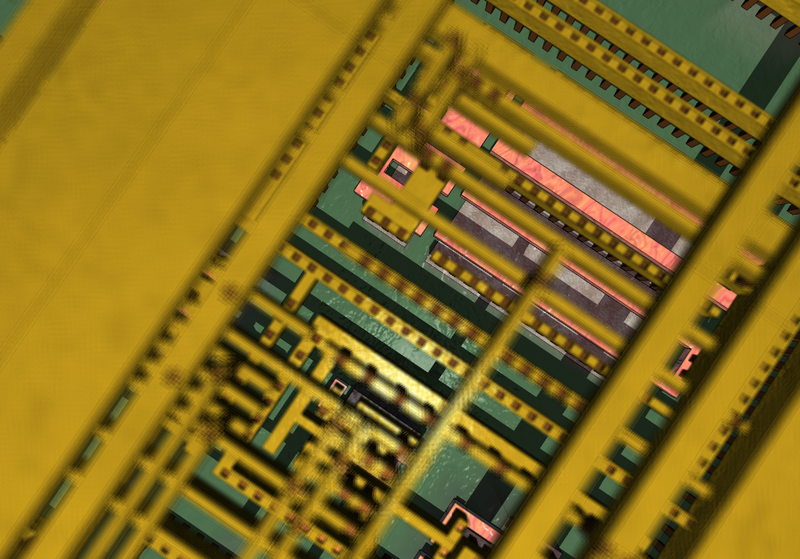 A semiconductor standard cell, close up. The pink parts are silicon.