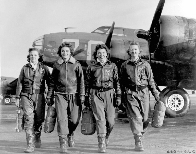 WWII These four female pilots leaving their ship, Pistol Packin' Mama, at the four engine school at Lockbourne AAF, Ohio, are members of a group of Women Airforce Service Pilots (WASPS)