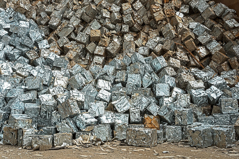 #115 - Blocks of compressed steel residue, typically from the pro- duction of new cans and barrels, which will go to steel mills for the production of new steel. Each block weighs approximately 150 kg.