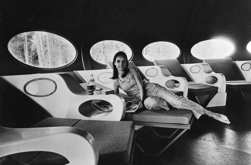 A woman reclines in the living room of a modern portable house called 'Futuro', 1969.