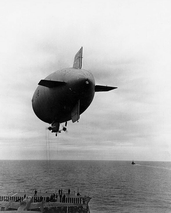 A US Navy L-8 blimp in action over the aircraft carrier USS Hornet.