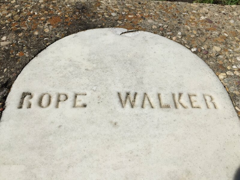 A detail of his original headstone.