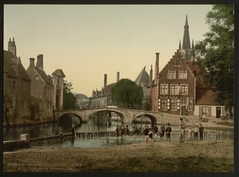 The bridge to the beguinage in Bruges, and the spire of Notre Dame.
