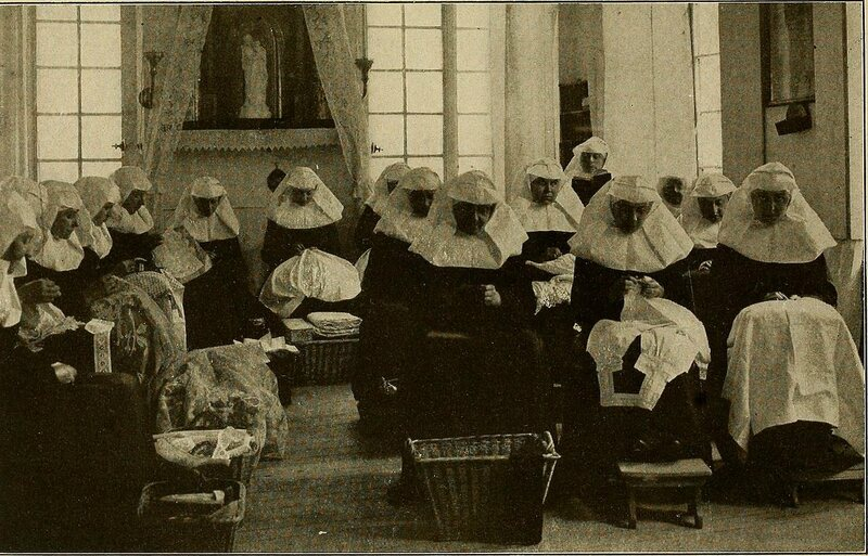 A group of beguines in the workroom of a beguinage in Ghent, Belgium, c. 1910.