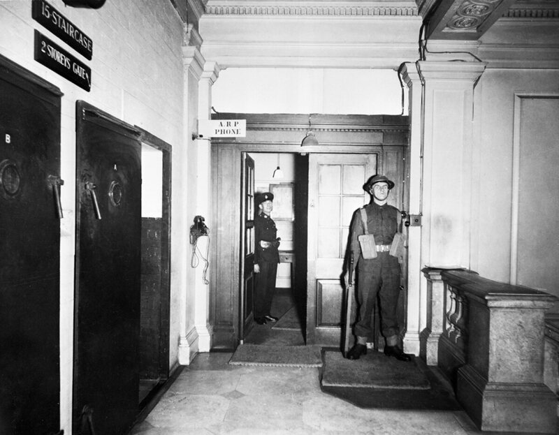 On the left is the internal door that led down into the War Rooms. The double doors at center led to the annex of 10 Downing Street, where Churchill and family lived from December 1940.