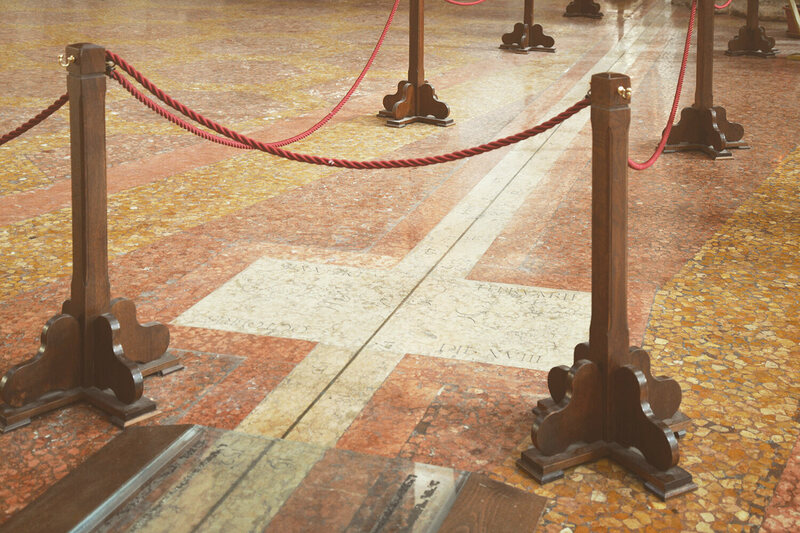 To help preserve the meridian line—but also to draw more attention to it—the  church has roped the line off from the feet of daily visitors. Just visible here, in a  plaque in the marble floor, are the zodiac signs of Pisces and Scorpio. Both  appear near the spring and autumn equinoxes, respectively.