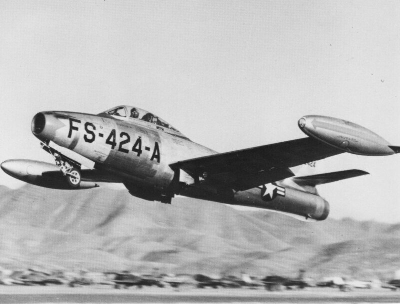 An F-84, laden with bombs and taking off for Korea.
