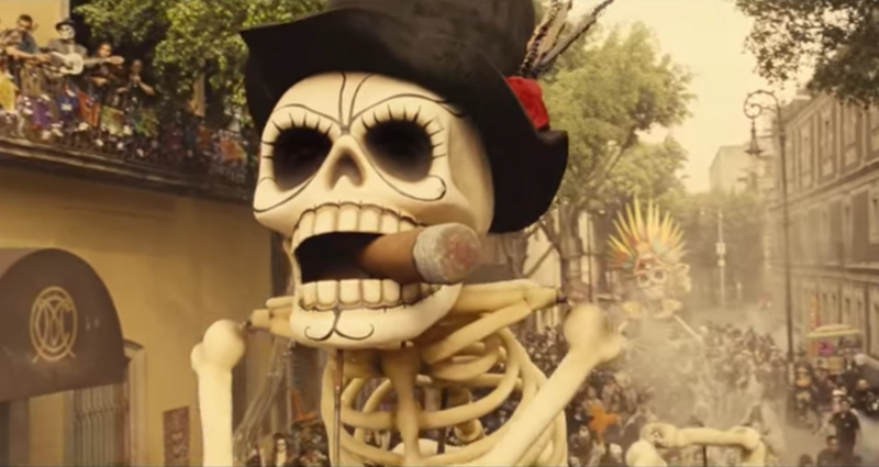 The opening scene of the Bond film <em>Spectre</em>, showing a Day of the Dead parade in Mexico City.