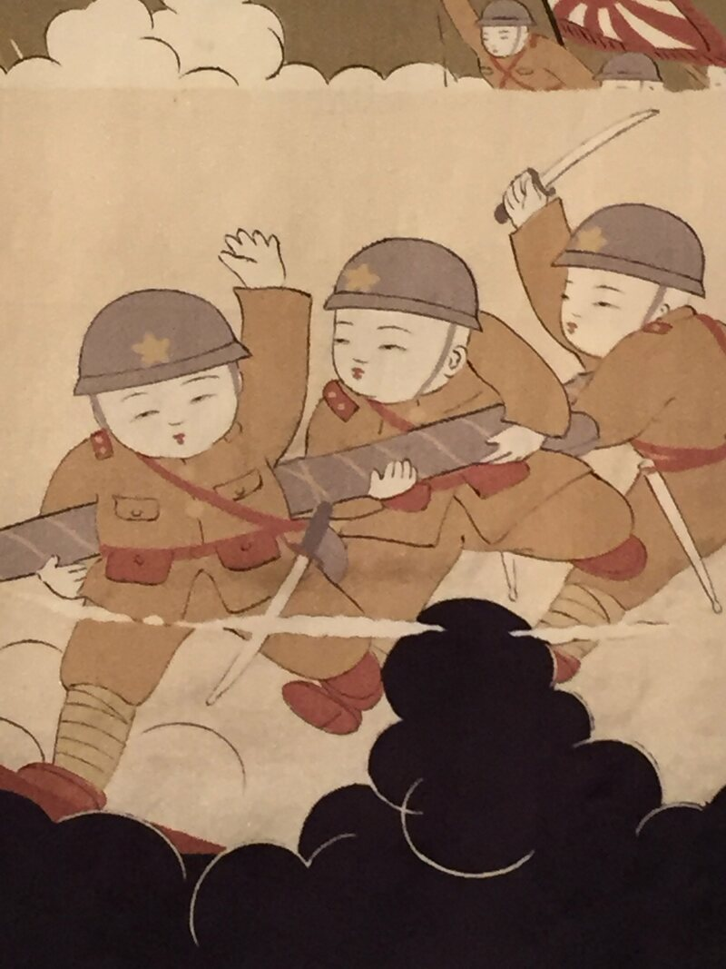 "A detail from a kimono showing the ""three brave bombers"", c. 1933."