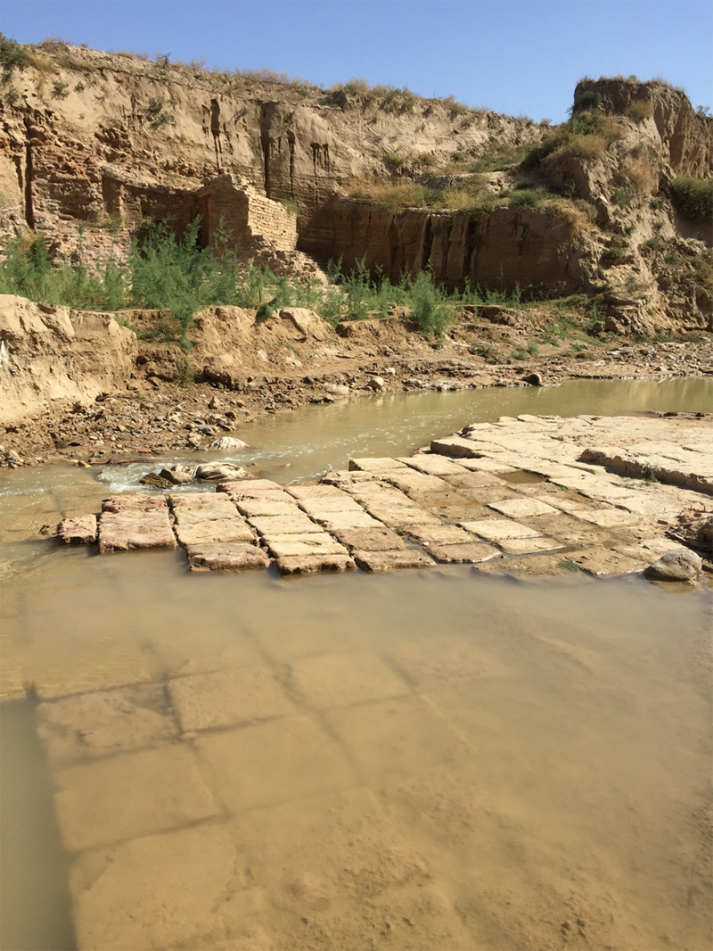Even the river bed was diverted and channeled through the wall's structures.