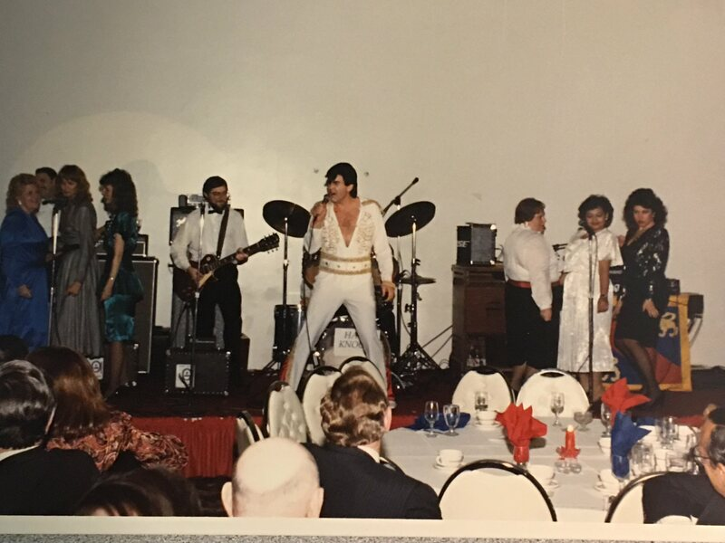John Hanks as Elvis with FAA chorale backup, 1989.