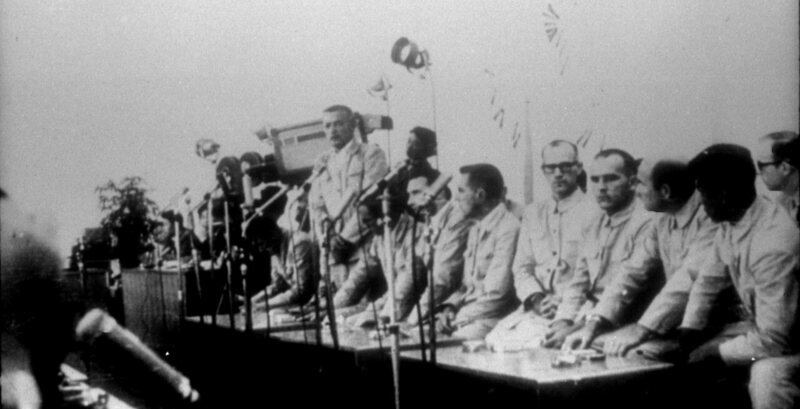 Crew members of the U.S.S. Pueblo at a press conference in North Korea, after their ship was captured.