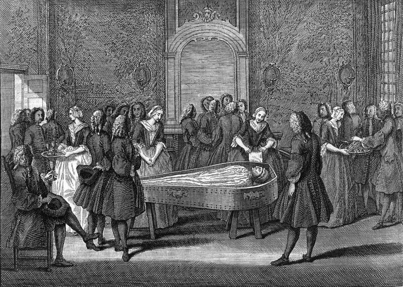 An 18th century funeral scene in England.