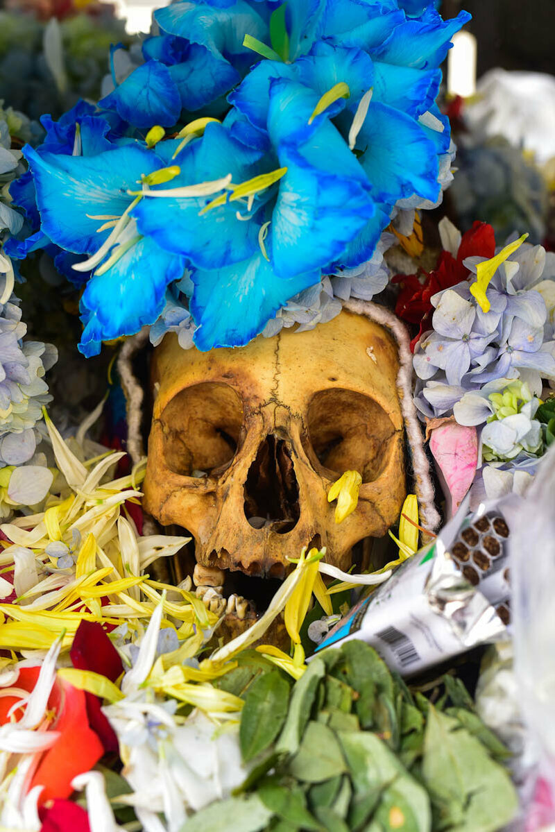 Flowers are the most common offering to the skulls, and by the end of the Fiesta can often overwhelm the natita itself.