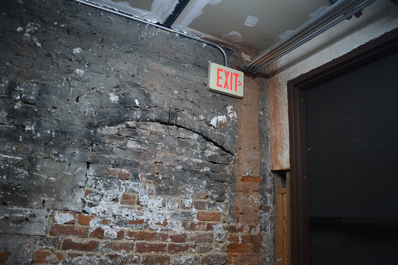 A bricked-in window found in the interior of the Loveman Building.