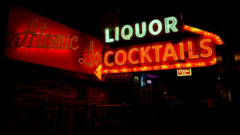 Atomic Liquors and its original neon signs, still glowing.