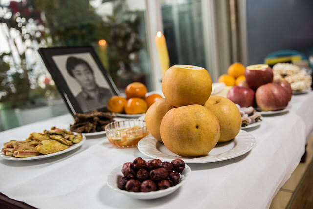 Food is placed on the ritual table in offering and memorial to ancestors.