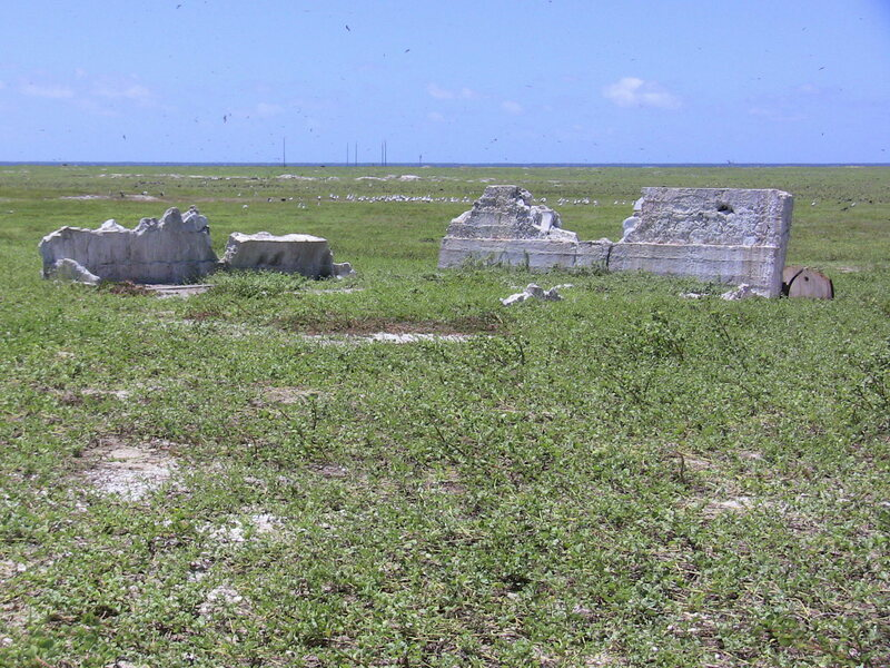 Settlement remains on Baker Island, with radio towers in the distance.