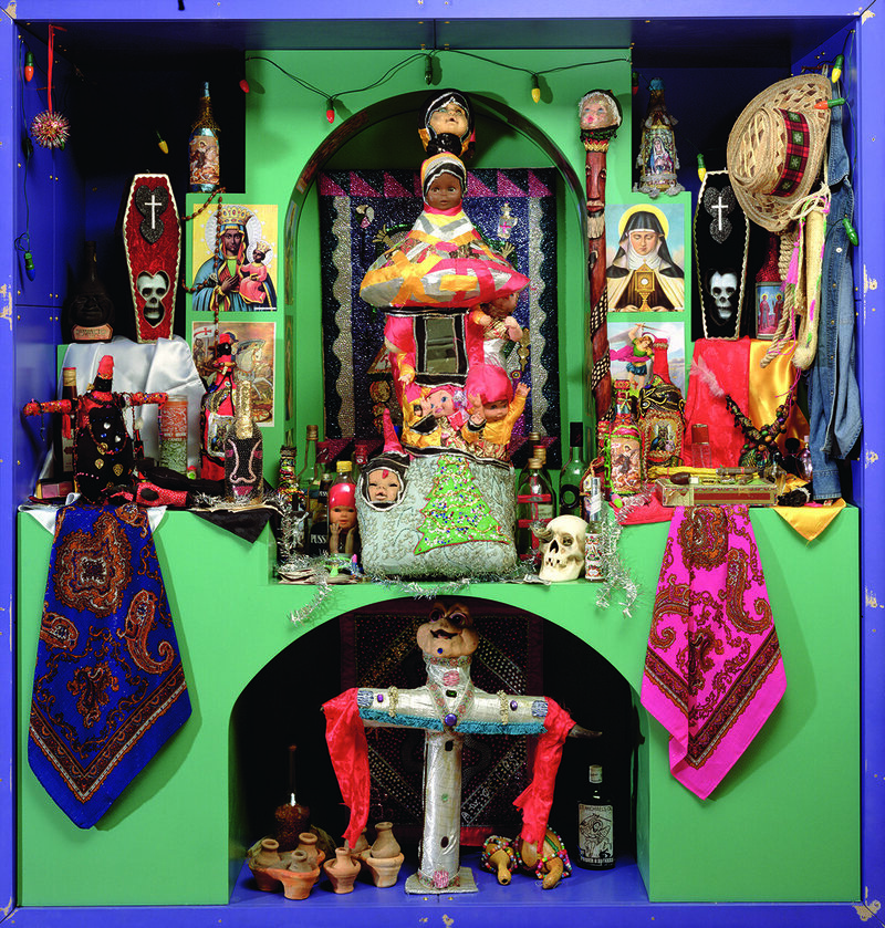 A Haitian voodoo altar, bringing together a wide range of symbolic objects and religious imagery.