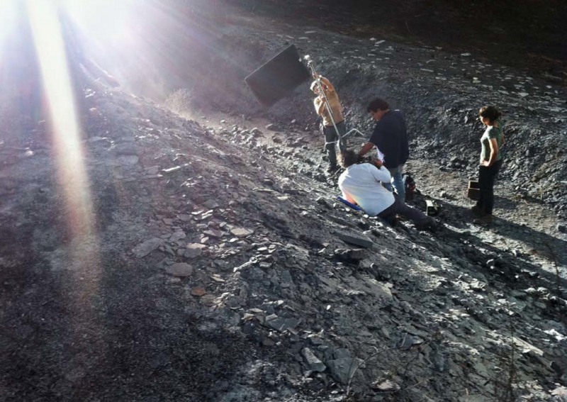 While filming C.H.Z., crew members reflect light onto the streambed.