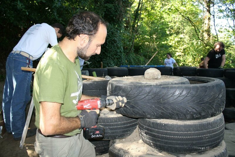 Florian Becquereau building the tire wall at the Trash Studio.