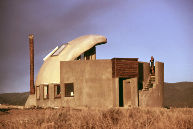 An early Earthship in Taos, New Mexico built with empty beer and soda cans.