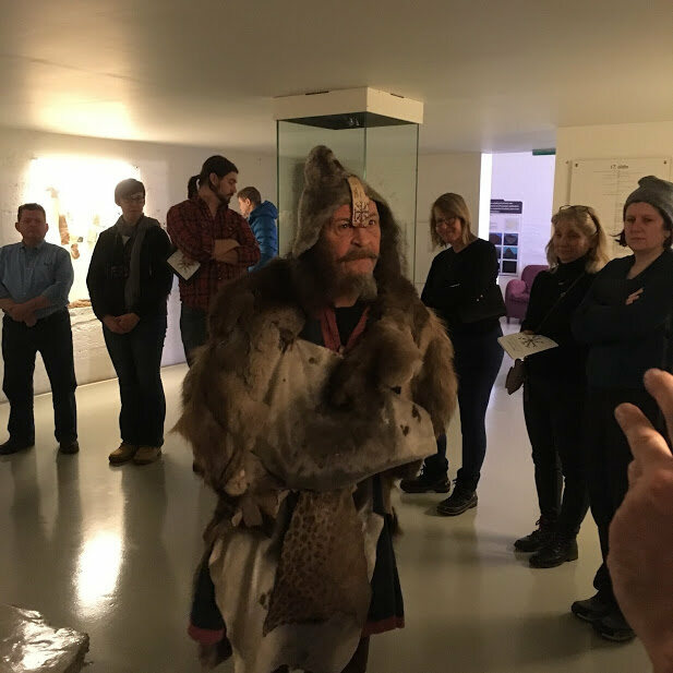 Siggi walks visitors through a ritual to banish an evil spirit.