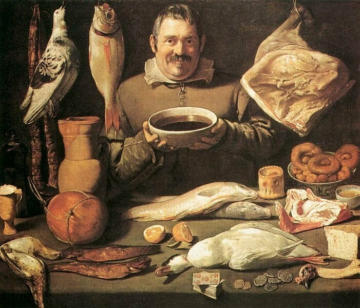 A 17th century chef surrounded by foods of the day.