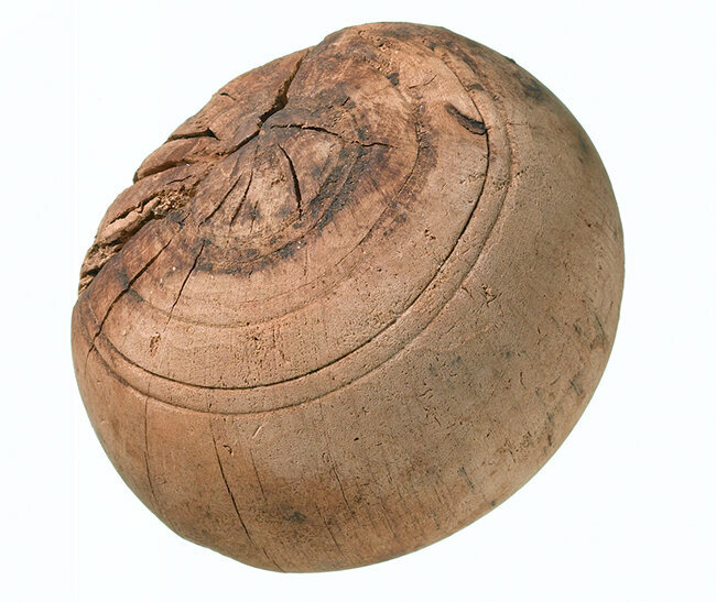 A wooden bowling ball unearthed by digging work for London's Crossrail project. It was discovered at the site of the Tudor King John's Court manor house in Stepney Green. It's now on display at a new exhibit, <em>Tunnel: The Archaeology of Crossrail</em>, at the Museum of London Docklands.
