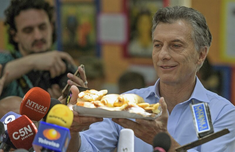 Politics and pastry have a long history in Argentina. Here current President (and former Buenos Aires Mayor) Mauricio Macri makes an offering to the press