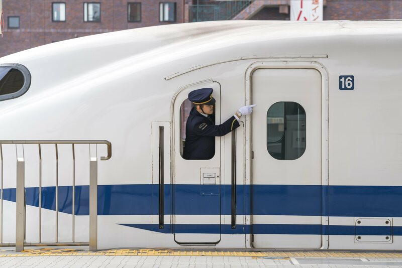 Guard on Shinkansen bullet train in Kyoto Station