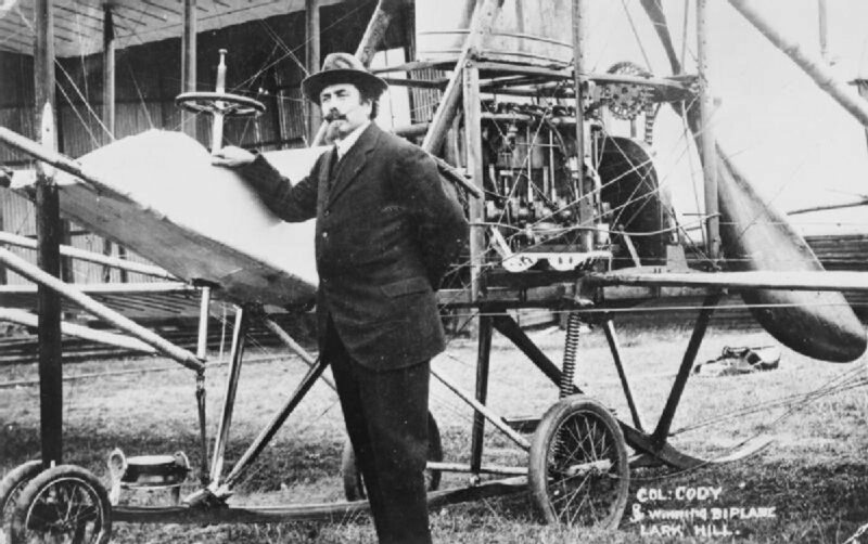 Cody in 1912, alongside his Mark V flying aircraft.