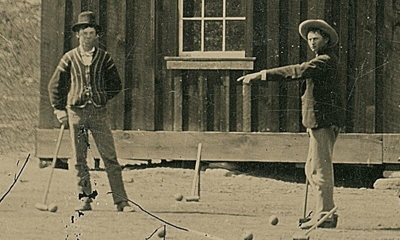 One of two confirmed photographs of Billy the Kid (left), playing croquet in New Mexico, 1878.