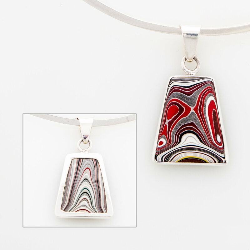 One of Piper's fordite pendants.