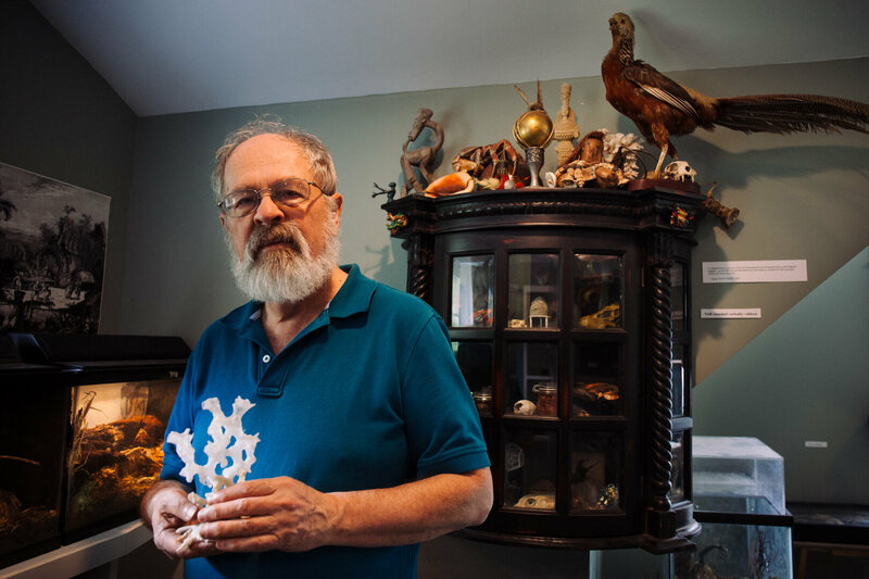 Jim Stewart in the Zymoglyphic Museum, holding one of his favorite Xenophora shells.