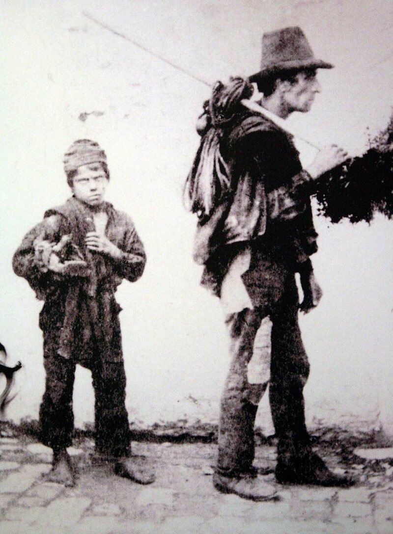 "A ""climbing boy"" and his boss, from 19th-century Italy."