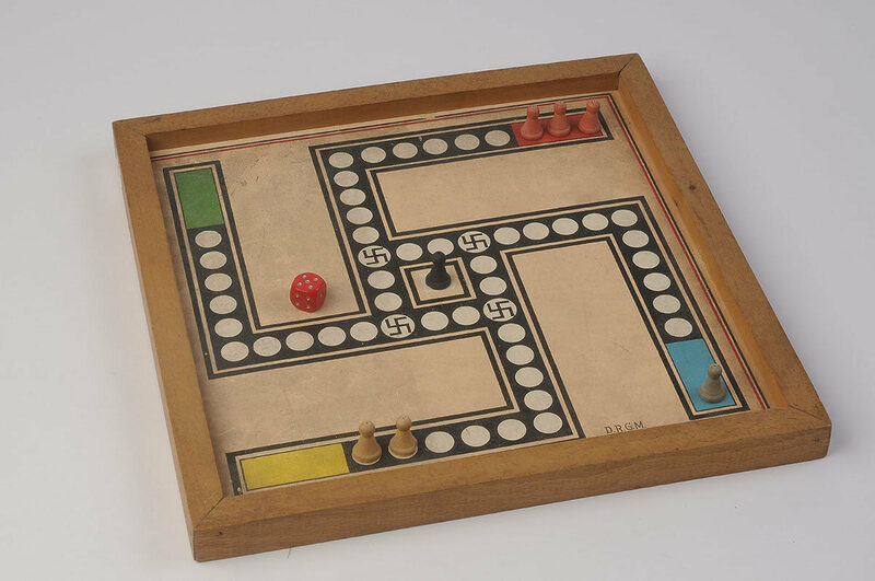 Swastikas studded the path to victory on a pachisi game made in Germany.