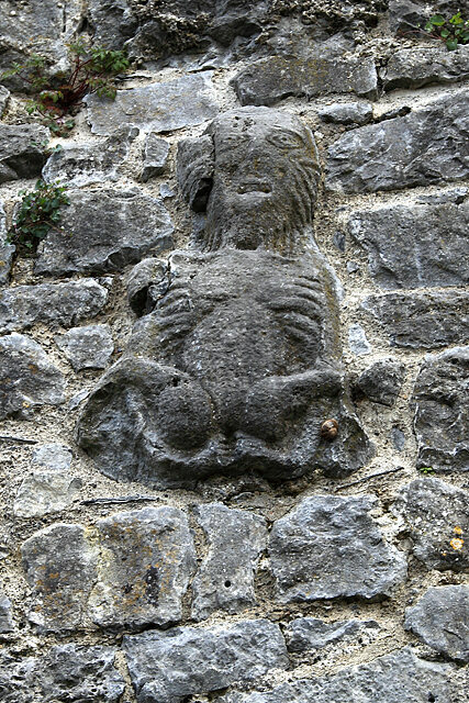 A weathered Sheela carved into a wall in Fethard, Ireland.