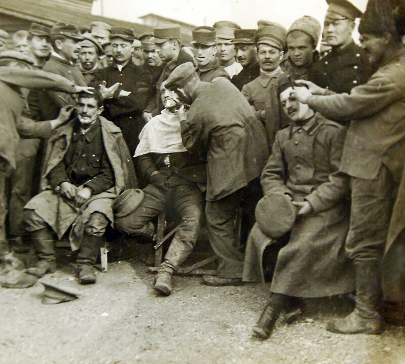 Allied POWs get a shave during WWI.