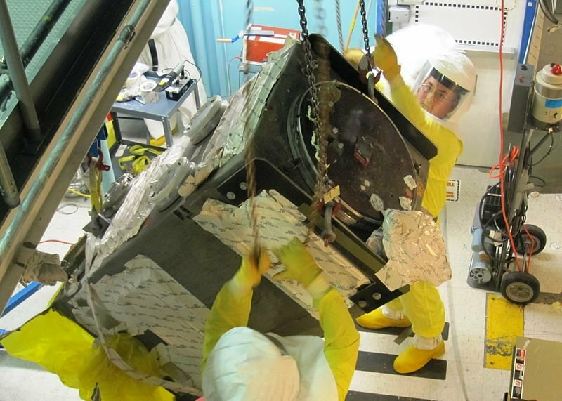 Technicians remove a contaminated glove box from the Plutonium Finishing Plant.