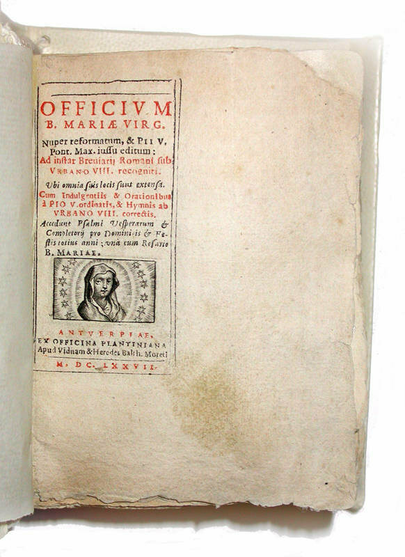 From 1677, <em>Officium Beatae Mariae Virginis</em>, in which a miniature layout sits in a larger book because the pages were never cut.