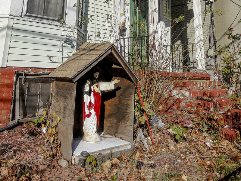 This Jesus has its own wooden house, complete with a shingled roof.