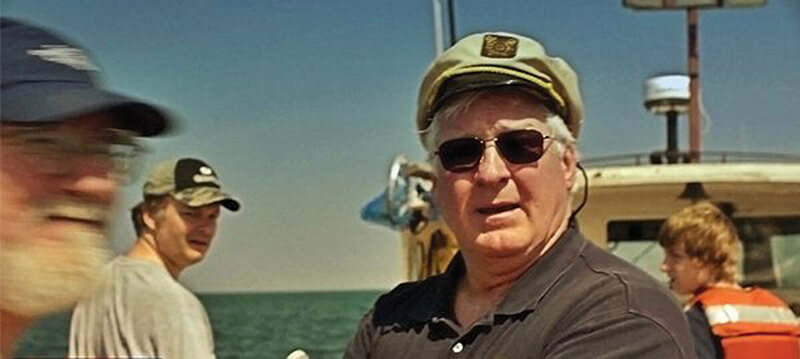 Steve Libert stands aboard a vessel during a Great Lakes Exploration Group expedition.