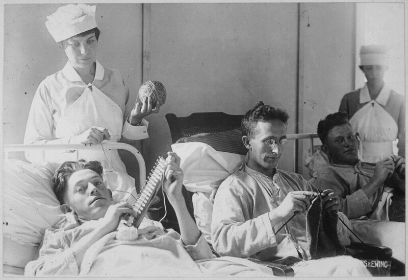 Bed-ridden soldiers knit during World War One.