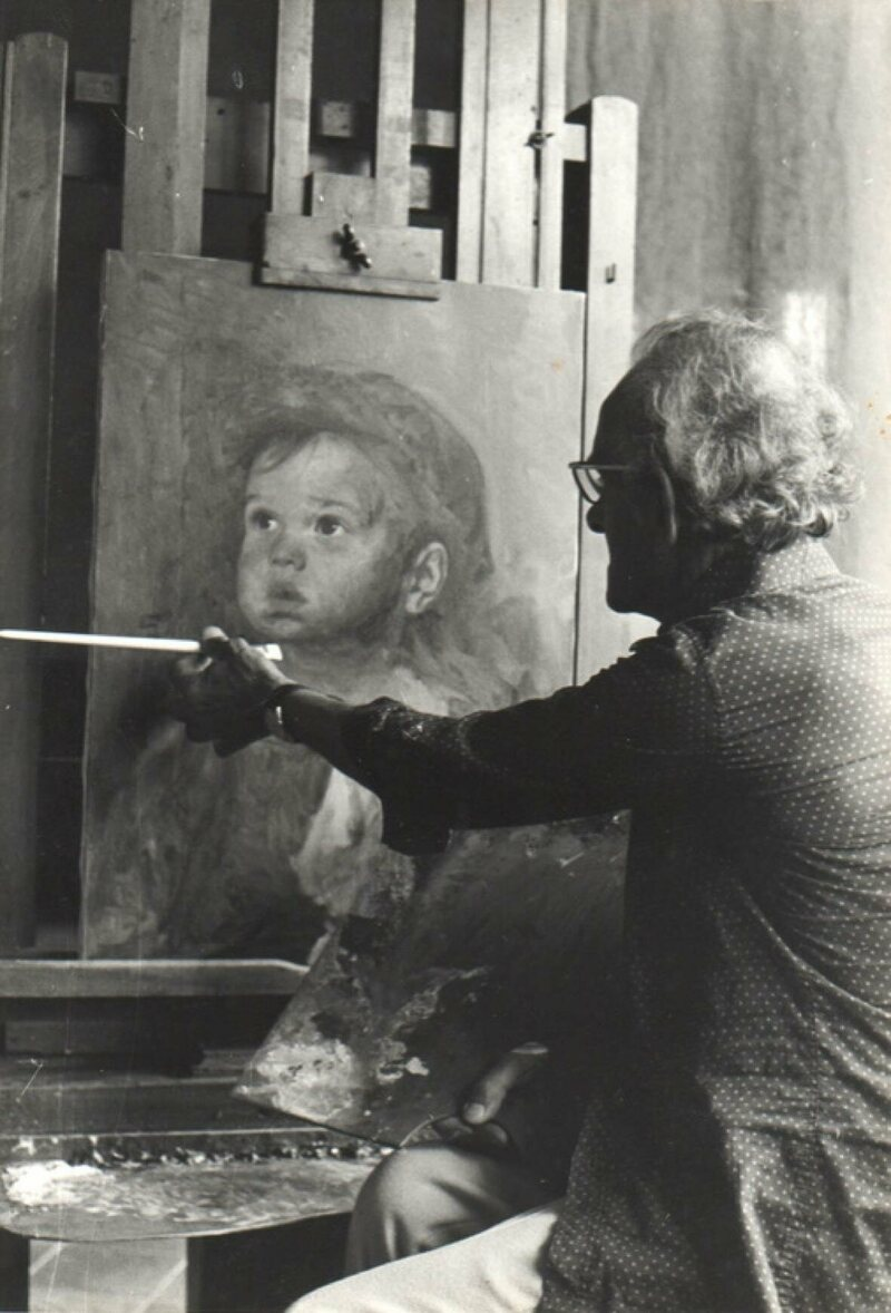 """Bruno Amadio painting a """"crying boy"""" artwork in his studio."""