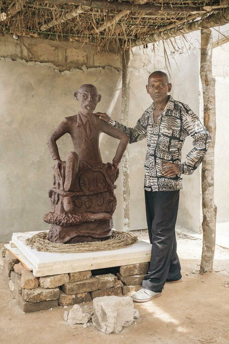 CATPC artist Jeremie Mabiala and his sculpture <em>The Art Collector</em> in the White Cube.